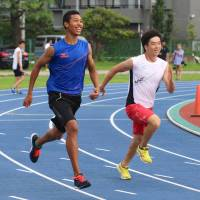 Japanese track phenom Abdul Hakim Sani Brown (left), seen in a file photo, is one of the most notable biracial athletes in the nation. | KAZ NAGATSUKA