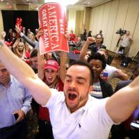Trump supporters react to news that Donald Trump will carry Florida. | JOE BURBANK/ORLANDO SENTINEL VIA AP