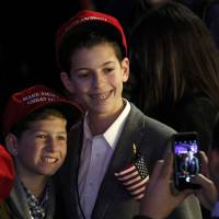 Young Trump supporters at an election night rally in Manhattan, New York.