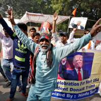 Members of Hindu Sena, a right-wing Hindu group, celebrate Donald Trump's victory in the U.S. elections, in New Delhi | REUTERS