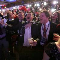Trump supporters at an election night rally in Manhattan, New York | REUTERS