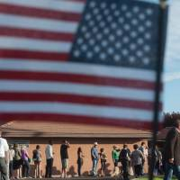 Voters wait in line to cast their ballots in Scottsdale, Arizona. | AFP-JIJI