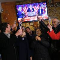Slovenian residents of Melania Trump's hometown celebrate the election of her husband | AFP PHOTO