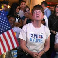 Supporters of Hillary Clinton father at a bar in Sydney to watch U.S. election results. | AFP PHOTO