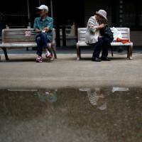 Slower tax revenue growth in aging Japan puts Abenomics at crossroads