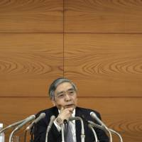 BOJ Gov. Haruhiko Kuroda speaks at a news conference at the central bank's Tokyo headquarters on Tuesday. | BLOOMBERG