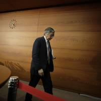 Bank of Japan Gov. Haruhiko Kuroda leaves a news conference at the central bank's headquarters in Tokyo Dec. 20. | BLOOMBERG