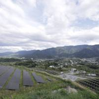 Rows of solar panels are seen in position at the Komekurayama solar power plant in Yamanashi Prefecture. | BLOOMBERG