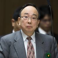 Masayoshi Amamiya, an executive director at the Bank of Japan, appears before the committee on financial affairs in the Upper House in Tokyo on Nov. 22. | BLOOMBERG