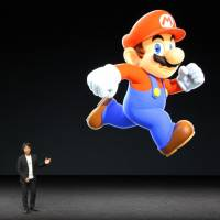 Shigeru Miyamoto of Nintendo Co., creator of the popular Super Mario character, makes a surprise appearance at Apple Inc.'s press event in San Francisco in September to announce the launch of a 'Super Mario' game for smartphones. | KYODO