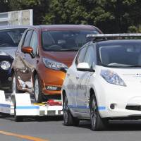 Nissan's driverless cars tow peers onto piers for loading
