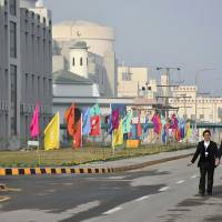 Pakistani officials walk before the inaugural ceremony of The Chashma-III reactor in Chashma, some 250 km (155 miles) southwest of Islamabad on Wednesday. Pakistan's fourth nuclear power plant went online Wednesday in a joint collaboration with China. | PAKISTAN PRIME MINISTER OFFICE / HANDOUT / AFP-JIJI