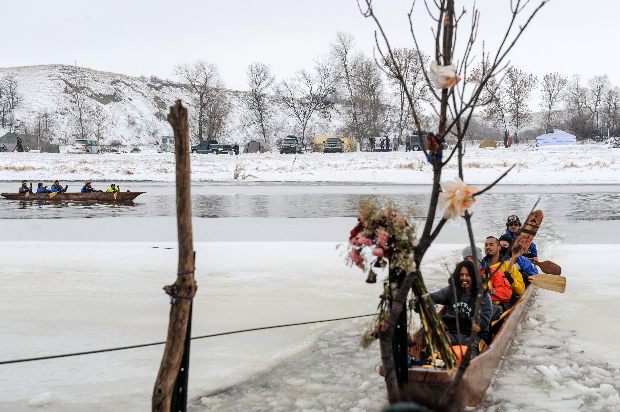 Traditional canoes approach the shore in the Oceti Sakowin camp during a protest over plans to pass the Dakota Access pipeline near the Standing Rock Indian Reservation, near Cannon Ball, North Dakota, Thursday. | REUTERS