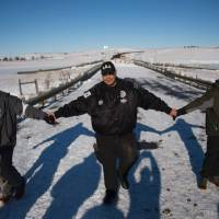 Protesters, vets cheer as Army Corps drops easement plan for Dakota Access pipeline
