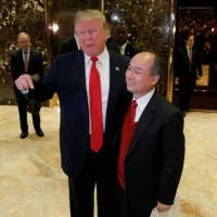 U.S. President-elect Donald Trump and Softbank CEO Masayoshi Son speak to the press after meeting at Trump Tower in Manhattan, New York, Tuesday. | REUTERS