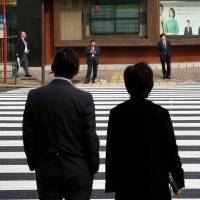 The current tax system trims the taxable annual income of a household's main earner by ¥380,000, but the benefit is lost if a dependent spouse — often a wife — earns more than ¥1.03 million a year. The latest proposal put forth by the ruling bloc raises the threshold to ¥1.5 million. | REUTERS