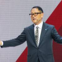 Toyota Motor Corp. President Akio Toyoda speaks during the Paris Motor Show in September. | KYODO