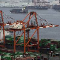 Japan posted a trade surplus for the third consecutive month in November. | BLOOMBERG