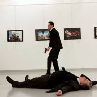 Cop in suit assassinates Russian ambassador during Ankara photo exhibit, shouts 'don't forget Aleppo'