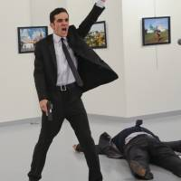 Witness to an assassination: AP photographer captures murder of Russian envoy in Turkey