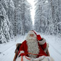Santa Claus rides in his sleigh on Dec. 15 as he prepares for Christmas in the Arctic Circle near Rovaniemi, Finland.   REUTERS