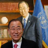 U.N. Secretary-General Ban Ki-moon smiles during the ceremony for the unveiling of his official portrait at United Nations headquarters in New York on Dec. 14. | REUTERS