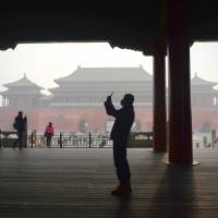 Beijing districts to cap population in bid to tackle smog, congestion