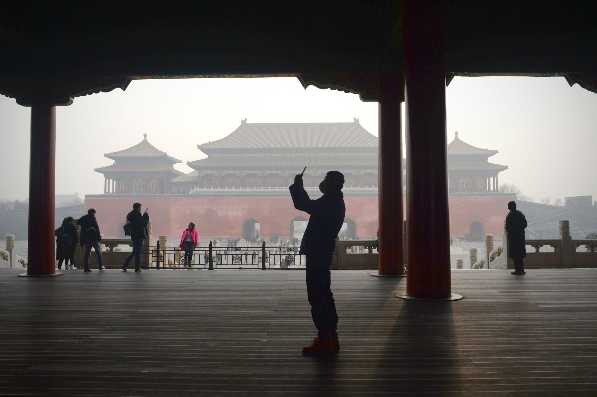 A man wearing a mask for protection against smog visits the Forbidden City in Beijing on Wednesday. | AFP-JIJI