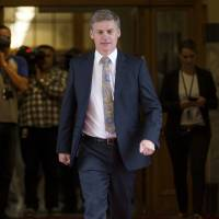 Deputy Prime Minister Bill English walks back to his office after a press conference at Parliament in Wellington on Monday following the resignation of New Zealand Prime Minister John Key. | NEW ZEALAND HERALD / VIA AP