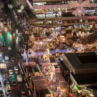 Defiant Berliners shun fear, reopen Christmas market after truck attack