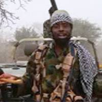 This screen grab image taken Thursday from a video released on YouTube by Islamist group Boko Haram shows Boko Haram leader Abubakar Shekau making a statement at an undisclosed location. The embattled leader, Abubakar Shekau, appeared in a new video disputing a claim by Nigerian President Muhammadu Buhari that the jihadi group had been routed from its Sambisa Forest stronghold. 'We are safe. We have not been flushed out of anywhere. And tactics and strategies cannot reveal our location except if Allah wills by his decree,' Shekau said in the 25-minute video, flanked by armed fighters. | BOKO HARAM / AFP-JIJI