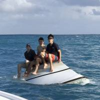 California teens plucked from flipped boat off Florida Keys after calling 911