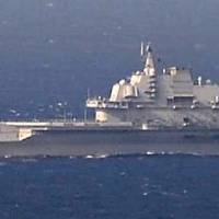 China carrier seen headed to Hainan as U.S. says it's OK with ship's drills in international waters