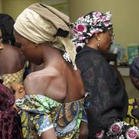 Nigeria keeps freed Chibok girls from spending Christmas at home till photo op is over