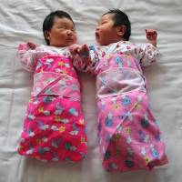 Newborn babies lie on a hospital bed in Beijing in this file photo from December 2008. China could further ease its childbirth policies, according to a government think tank. | AFP-JIJI