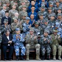 U.S. Army Pacific commander Gen. Robert Brown (front row center) and Gen. Liu Xiaowu (front row, third right), the commander for Southern Theater Command Army of Chinese Liberation Army, applaud with their soldiers at a group photo session after conducting the U.S.-China Disaster Management Exchange drill at a PLA training base in Kunming, China on Nov. 18. | AP