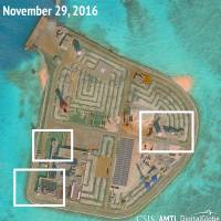 The Asia Maritime Transparency Initiative says this satellite image appears to show anti-aircraft guns and close-in weapons systems on the artificial island of Johnson Reef in the South China Sea. | REUTERS
