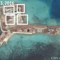 The Asia Maritime Transparency Initiative says this satellite image shows anti-aircraft guns and close-in weapons systems on the artificial island of Hughes Reef in the South China Sea. | REUTERS