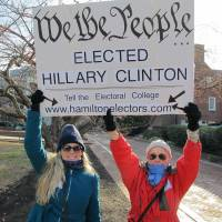 Cheryl Kreiser (right) and Krista Keyes demonstrate in front of the Maryland State House in Annapolis Monday hours before Maryland's 10 electors were scheduled to cast the state's electoral votes for Hillary Clinton. | AP