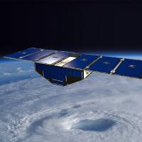 An illustration of one of the eight Cyclone Global Navigation Satellite System satellites deployed above a hurricane. | NASA