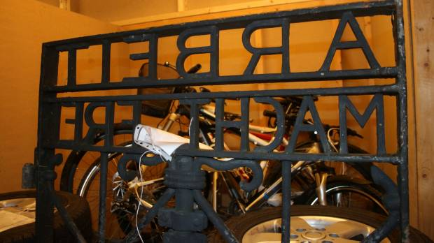 Stolen Dachau 'Work will set you free' gate is recovered in Norway