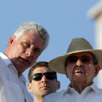 Cuban Vice President Miguel Diaz-Canel (left) talks to President Raul Castro during a May Day parade in Havana this year. | REUTERS