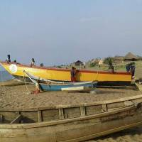 The ill-fated yellow boat is brought back ashore from Lake Albert Monday in Buliisa, western Uganda, after it capsized with some 45 people aboard. At least 30 Ugandan members of a village football team and their fans drowned when their boat capsized during a party. | AFP-JIJI
