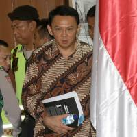 Jakarta Gov. Basuki Tjahaja Purnama, better known by his nickname 'Ahok,' enters the courtroom before his trial at the North Jakarta District Court in Jakarta on Tuesday. | AFP-JIJI
