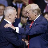 U.S. President-elect Donald Trump introduces retired Marine Corps Gen. James Mattis as his appointed Secretary of Defense while speaking to supporters during a rally in Fayetteville, North Carolina, on Tuesday. | AP