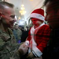 Christmas in Iraq brings sense of deja vu for U.S. troops, some on repeat tours
