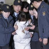South Korea's detained 'Rasputin' snubs lawmakers from jail cell