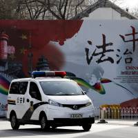 Beijing fires four of five police officers involved in alleged brutality case