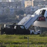 Libyan pair claim innocence, are charged in Malta with hijacking jetliner
