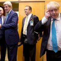 British Foreign Secretary Boris Johnson (right) attends a NATO foreign ministers meeting at the Alliance headquarters in Brussels on Tuesday, with U.S. Secretary of State John Kerry (second from left) and Turkish Foreign Minister Mevlut Cavusoglu (left) standing nearby. British Prime Minister Theresa May was on Thursday forced to issue a clarification over recent comments Johnson made about the Middle East. | POOL / VIA REUTERS